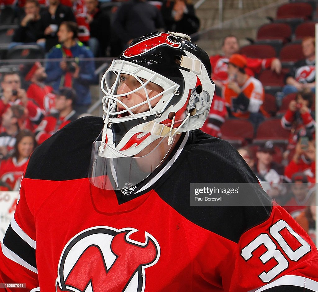 Goalie Martin Brodeur #30 of the New Jersey looks up during an NHL hockey game against the Philadelphia Flyers at Prudential Center on November 2, 2013 in Newark, New Jersey.
