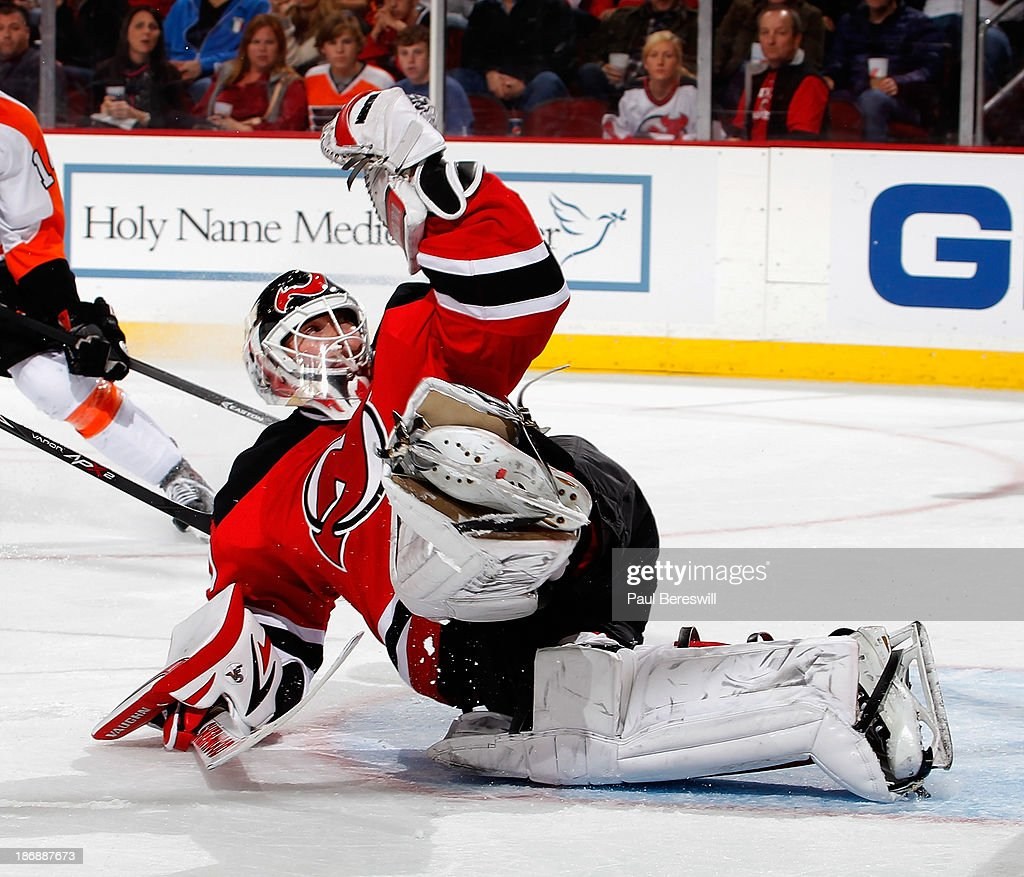 Goalie Martin Brodeur #30 of the New Jersey makes a save during an NHL hockey game against the Philadelphia Flyers at Prudential Center on November 2, 2013 in Newark, New Jersey.