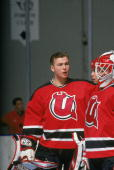 Goalie Martin Brodeur of the Utica Devils talks with Corey Schwab before an AHL game against the New Haven Senators on January 24 1993 at the New...