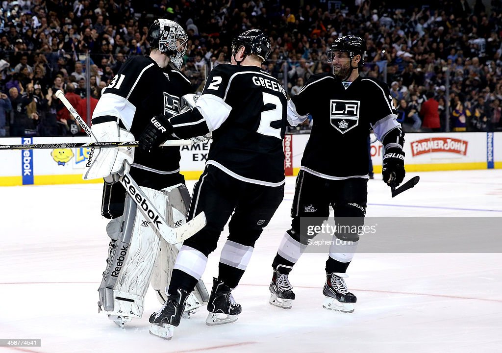 Goalie Martin Jones of the Los Angeles Kings is greeted by Matt Greene and Slava Voynov after Jones stopped all three Colorado Avalanche shots in the...