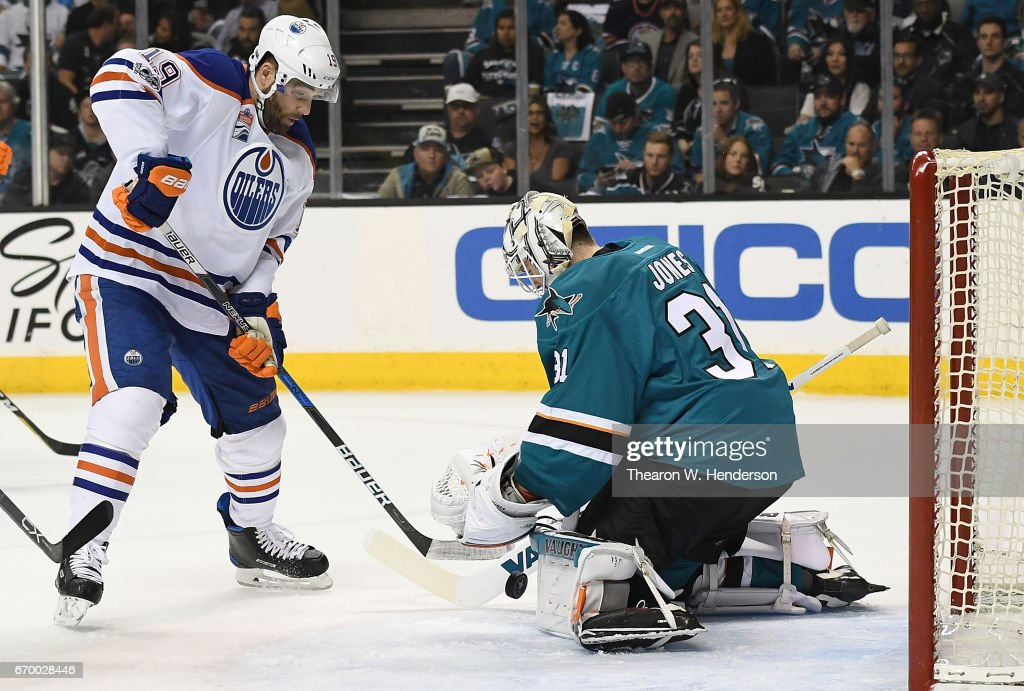 Goalie Martin Jones #31 of the San Jose Sharks blocks the shot of Patrick Maroon #19 of the Edmonton Oilers during the first period in Game Four of the Western Conference First Round during the 2017 NHL Stanley Cup Playoffs at SAP Center on April 18, 2017 in San Jose, California.