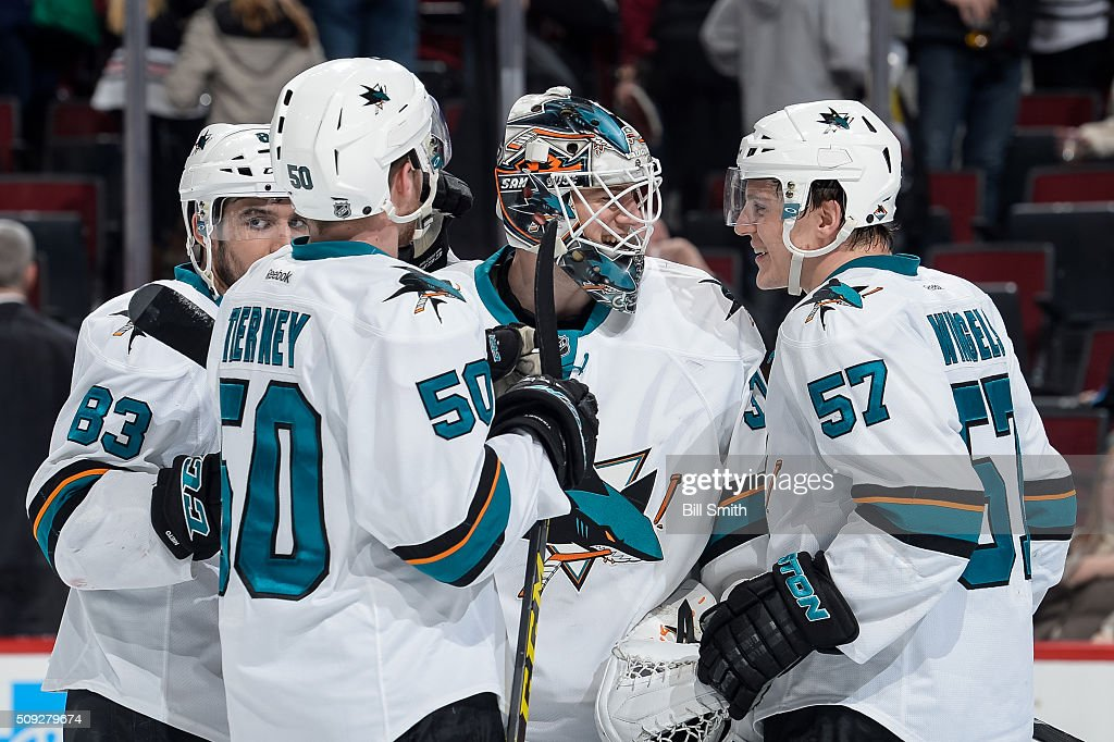 Goalie Martin Jones of the San Jose Sharks celebrates with Tommy Wingels after defeating the Chicago Blackhawks 2 to 0 during the NHL game at the...