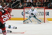 Goalie Martin Jones of the San Jose Sharks positions himself for a save on the shot by Michael Stone of the Arizona Coyotes during the second period...