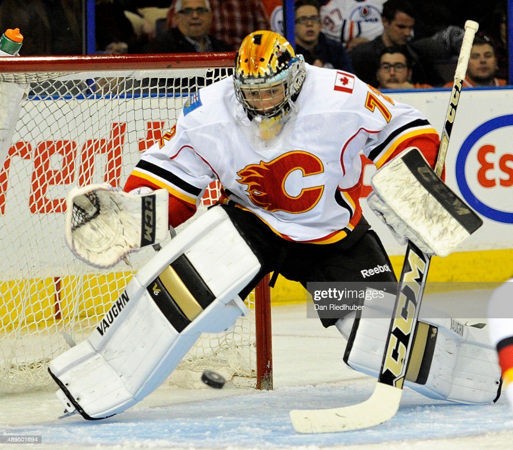 Goalie Mason McDonald #72 of the Calgary Flames makes a save against the Edmonton Oilers at Rexall Place on September 21, 2015 in Edmonton, Alberta, Canada.