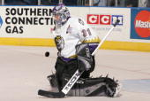 Goalie Mathieu Garon of the Manchester Monarchs makes a save during a American Hockey League game against the Bridgeport Sound Tigers at the Arena at...
