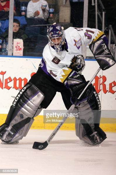 Goalie Mathieu Garon of the Manchester Monarchs plays the puck during a American Hockey League game against the Bridgeport Sound Tigers at the Arena...