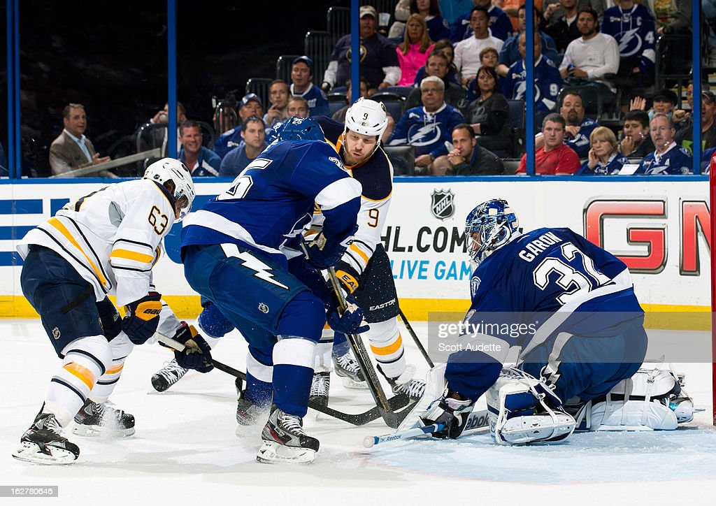 Goalie <a gi-track='captionPersonalityLinkClicked' href=/galleries/search?phrase=Mathieu+Garon&family=editorial&specificpeople=206119 ng-click='$event.stopPropagation()'>Mathieu Garon</a> #32 of the Tampa Bay Lightning blocks <a gi-track='captionPersonalityLinkClicked' href=/galleries/search?phrase=Steve+Ott&family=editorial&specificpeople=210616 ng-click='$event.stopPropagation()'>Steve Ott</a> #9 and <a gi-track='captionPersonalityLinkClicked' href=/galleries/search?phrase=Tyler+Ennis+-+Ice+Hockey+Player&family=editorial&specificpeople=4754184 ng-click='$event.stopPropagation()'>Tyler Ennis</a> #63 of the Buffalo Sabres during the second period of the game at the Tampa Bay Times Forum on February 26, 2013 in Tampa, Florida.