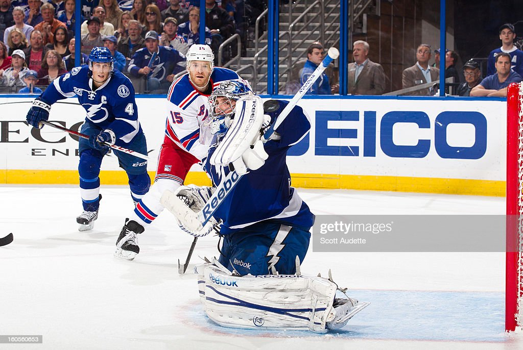 Goalie <a gi-track='captionPersonalityLinkClicked' href=/galleries/search?phrase=Mathieu+Garon&family=editorial&specificpeople=206119 ng-click='$event.stopPropagation()'>Mathieu Garon</a> #32 of the Tampa Bay Lightning blocks the puck during the second period of their game against the New York Rangers at the Tampa Bay Times Forum on February 2, 2013 in Tampa, Florida.