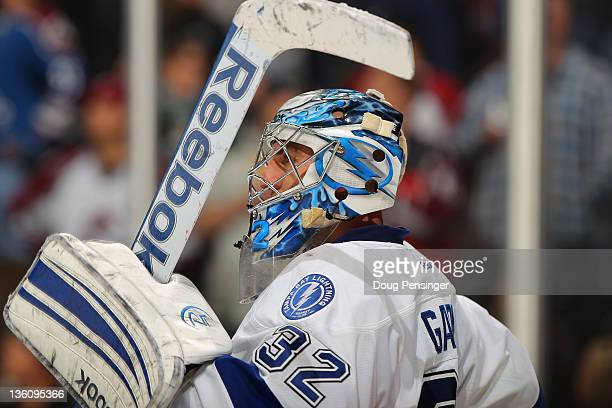 Goalie Mathieu Garon of the Tampa Bay Lightning defends the goal against the Colorado Avalanche at the Pepsi Center on December 23 2011 in Denver...