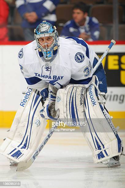 Goalie Mathieu Garon of the Tampa Bay Lightning warms up prior to facing the Colorado Avalanche at the Pepsi Center on December 23 2011 in Denver...