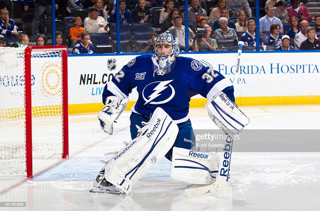 Goalie Mathieu Garon #32 of the Tampa Bay Lightning watches the game action during the second period of the game against the Washington Capitals at the Tampa Bay Times Forum on February 14, 2013 in Tampa, Florida.