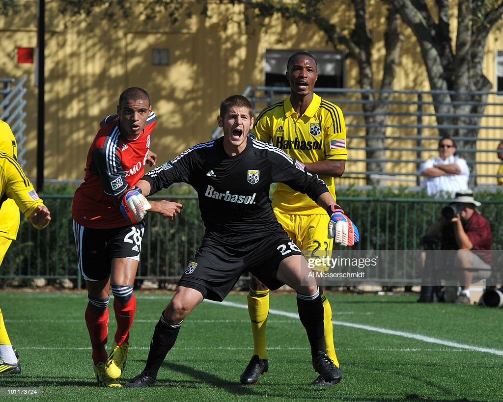 Goalie Matt Lampson #28 of the Columbus Crew looks for a shot by Toronto FC February 9, 2013 in the first round of the Disney Pro Soccer Classic in Orlando, Florida. Columbus won 1 - 0.