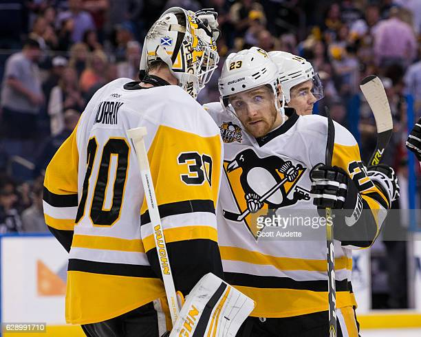 Goalie Matt Murray and Scott Wilson of the Pittsburgh Penguins celebrate the win against the Tampa Bay Lightning at Amalie Arena on December 10 2016...