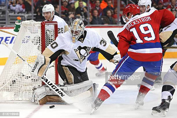 Goalie Matt Murray of the Pittsburgh Penguins makes a save on Nicklas Backstrom of the Washington Capitals during the second period at Verizon Center...