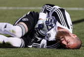 Goalie Matt Pickens of Colorado Rapids holds his left arm after a play at the goal during the first half of an MLS soccer game against Real Salt Lake...