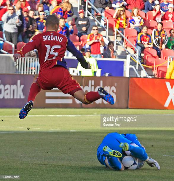Goalie Matt Reis of the New Engeland Revolution takes the ball from Alvaro Saborio of Real Salt Lake during the first half of an MLS soccer game May...