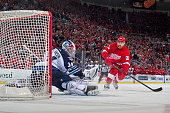 Goalie Michael Hutchinson of the Winnipeg Jets makes a glove save on Tomas Tatar of the Detroit Red Wings in a shootout attempt during a NHL game on...