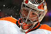 Goalie Michal Neuvirth of the Philadelphia Flyers spits water before the second period against the Washington Capitals at Verizon Center on January...