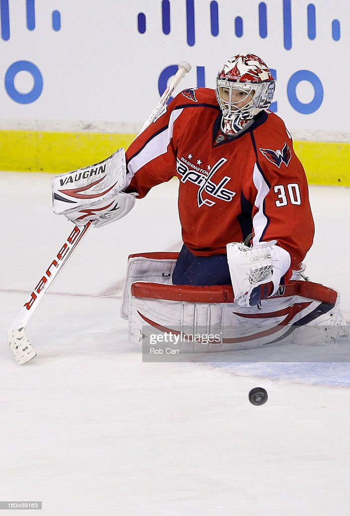 Goalie <a gi-track='captionPersonalityLinkClicked' href=/galleries/search?phrase=Michal+Neuvirth&family=editorial&specificpeople=3205600 ng-click='$event.stopPropagation()'>Michal Neuvirth</a> #30 of the Washington Capitals deflects a shot by the New York Rangers during the third period at Verizon Center on March 10, 2013 in Washington, DC.
