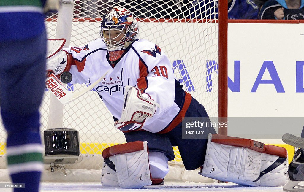 Goalie <a gi-track='captionPersonalityLinkClicked' href=/galleries/search?phrase=Michal+Neuvirth&family=editorial&specificpeople=3205600 ng-click='$event.stopPropagation()'>Michal Neuvirth</a> #30 of the Washington Capitals dives to make a save against the Vancouver Canucks during the first period in NHL action on October 28, 2012 at Rogers Arena in Vancouver, British Columbia, Canada.