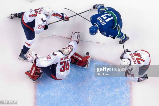 Goalie Michal Neuvirth of the Washington Capitals makes a toe save while Ryan Kesler of the Vancouver Canucks and Karl Alzner of the Washington...