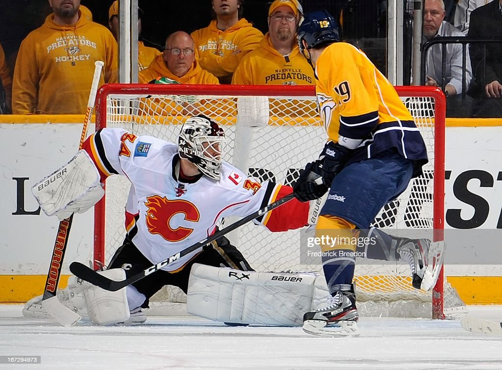 Goalie Miikka Kiprusoff #34 of the Calgary Flames makes a save on Bobby Butler #19 of the Nashville Predators at the Bridgestone Arena on April 23, 2013 in Nashville, Tennessee.