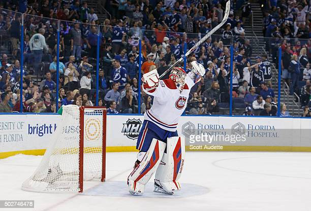 Goalie Mike Condon of the Montreal Canadiens celebrates the win against the Tampa Bay Lightning at the Amalie Arena on December 28 2015 in Tampa...