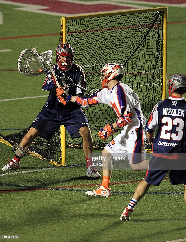 Goalie Mike Gabel #9 of the Boston Commons makes a save as Martin Cahill #34 of the Hamilton Nationals hits his stick, as Ryan Mizolek #23 of the Boston Cannons looks on in the fourth quarter at Harvard Stadium May 4, 2013 in Boston, Massachusetts. The Hamilton Nationals defeated the Boston Cannons 15-8.