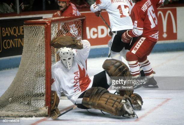 Goalie Mike Liut of Canada falls to the ice while defending the net during the 1981 Canada Cup Final against the Soviet Union on September 13 1981 at...