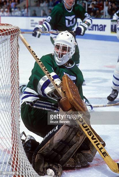 Goalie Mike Liut of the Hartford Whalers defends the net during an NHL game against the Quebec Nordiques circa 1988 at the Quebec Coliseum in Quebec...