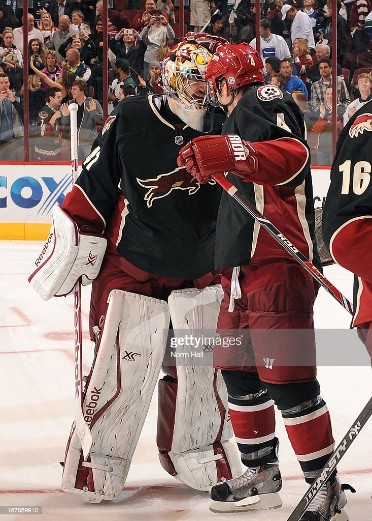 Goalie Mike Smith #41 and <a gi-track='captionPersonalityLinkClicked' href=/galleries/search?phrase=Zbynek+Michalek&family=editorial&specificpeople=243230 ng-click='$event.stopPropagation()'>Zbynek Michalek</a> #4 of the Phoenix Coyotes celebrate their 3-2 shootout victory over the Vancouver Canucks at Jobing.com Arena on November 5, 2013 in Glendale, Arizona.