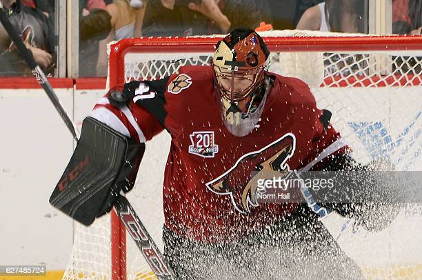 Goalie Mike Smith of the Arizona Coyotes makes a save on a shot by the Columbus Blue Jackets during the second period at Gila River Arena on December...