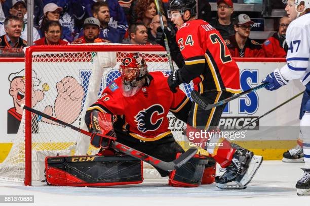 Goalie Mike Smith of the Calgary Flames guards the net in an NHL game against the Toronto Maple Leafs at the Scotiabank Saddledome on November 28...