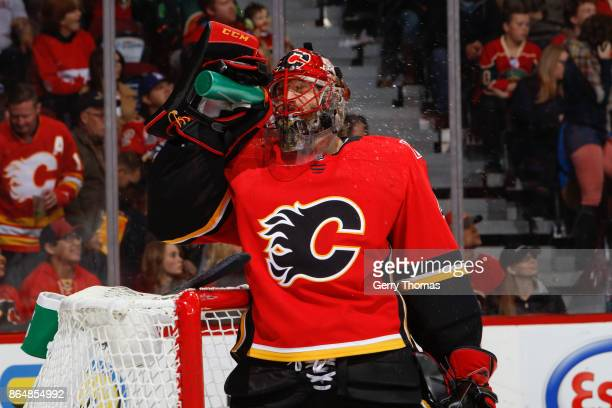Goalie Mike Smith of the Calgary Flames splashes water on his face in an NHL game against the Minnesota Wild at the Scotiabank Saddledome on October...