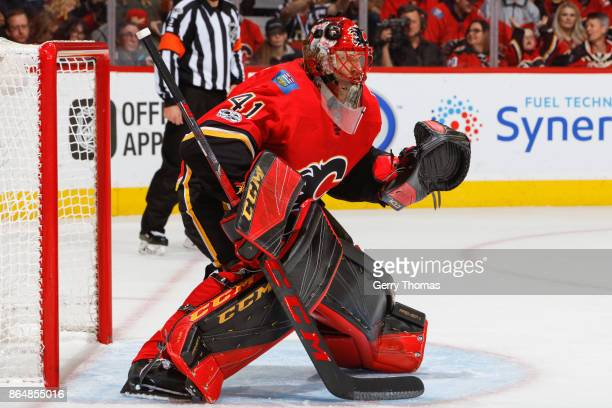 Goalie Mike Smith of the Calgary Flames stands in guard in an NHL game against the Minnesota Wild at the Scotiabank Saddledome on October 21 2017 in...