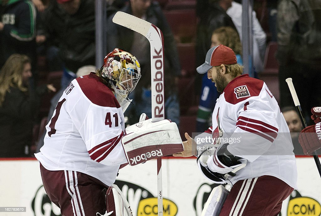 Goalie Mike Smith #41 of the Phoenix Coyotes is congratulated by teammate goalie Jason LaBarbera #1 after defeating the Vancouver Canucks 4-2 during NHL action on February 26, 2013 at Rogers Arena in Vancouver, British Columbia, Canada.
