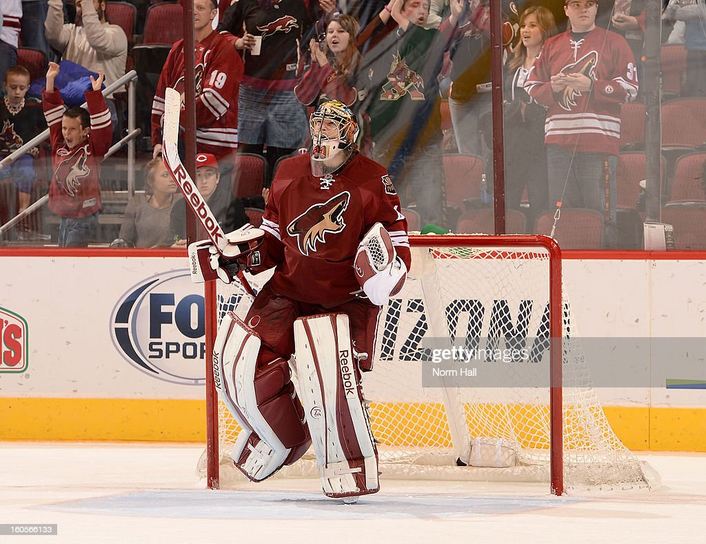 Goalie Mike Smith #41 of the Phoenix Coyotes pumps his fist after a 2-0 shutout against the Dallas Stars at Jobing.com Arena on February 2, 2013 in Glendale, Arizona.