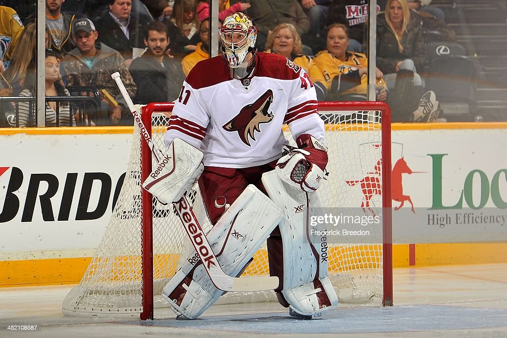 Goalie Mike Smith #41 of the Phoenix Coyotes skates against the Nashville Predators at Bridgestone Arena on November 25, 2013 in Nashville, Tennessee.