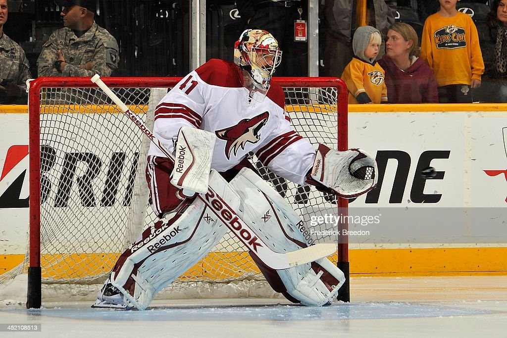 Goalie Mike Smith #41 of the Phoenix Coyotes warms up prior to a game against the Nashville Predators at Bridgestone Arena on November 25, 2013 in Nashville, Tennessee.