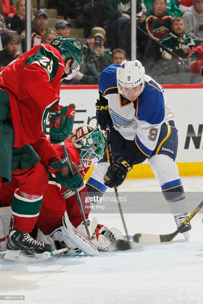Goalie <a gi-track='captionPersonalityLinkClicked' href=/galleries/search?phrase=Niklas+Backstrom&family=editorial&specificpeople=861018 ng-click='$event.stopPropagation()'>Niklas Backstrom</a> #32 of the Minnesota Wild covers up the puck as Jaden Schwartz #9 of the St. Louis Blues attempts to score during the game on April 1, 2013 at the Xcel Energy Center in Saint Paul, Minnesota.