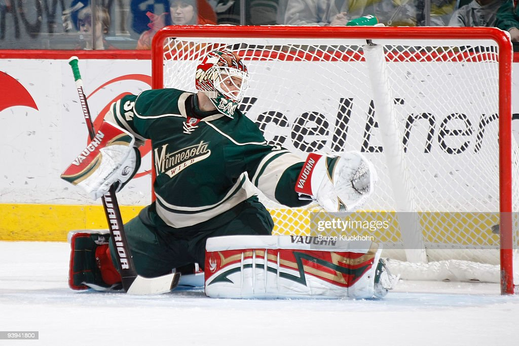 Goalie Niklas Backstrom of the Minnesota Wild gives up a goal to Bobby Ryan of the Anaheim Ducks during the game at the Xcel Energy Center on...