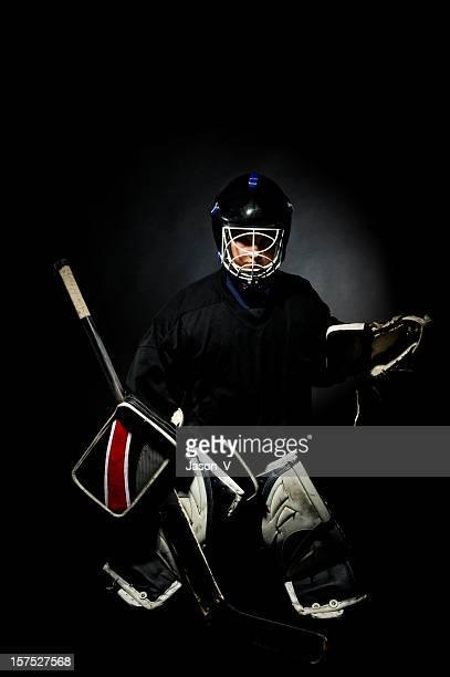 Goalie on a black background