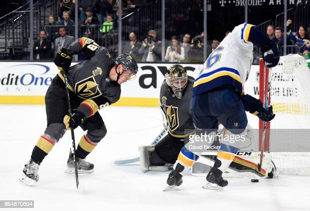Goalie Oscar Dansk of the Vegas Golden Knights protects his goal from Paul Stastny of the St Louis Blues as Nate Schmidt of the Vegas Golden Knights...