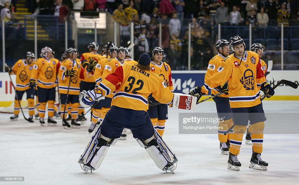 Goalie Oscar Setanen #32 of Lukko Rauma celebrates with the team at the end of the Champions Hockey League group stage game at the National Ice Centre in Nottingham, between Nottingham Panthers and Lukko Rauma on August 22, 2014 in Nottingham, United Kingdom.
