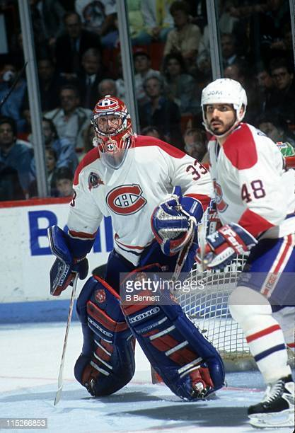 Goalie Patrick Roy and JJ Daigneault of the Montreal Canadiens defend the net during an NHL game circa 1993 at the Montreal Forum in Montreal Quebec...