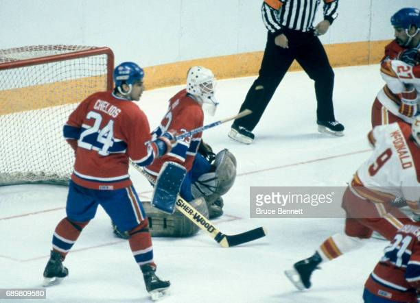 Goalie Patrick Roy and teammate Chris Chelios of the Montreal Candiens follow the play during a game in the 1986 Stanley Cup Finals against the...