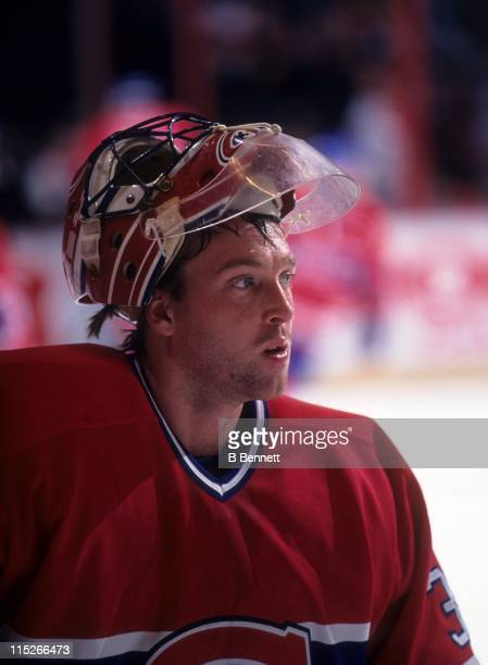 Goalie Patrick Roy of the Montreal Canadiens looks on during an NHL game in April 1995