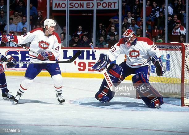 Goalie Patrick Roy of the Montreal Canadiens makes the blocker save as Lyle Odelein defends during their game against the New York Rangers on...