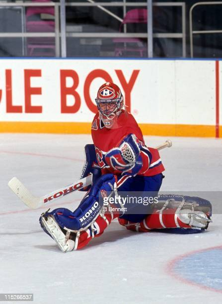 Goalie Patrick Roy of the Montreal Canadiens makes the glove save during an NHL game against the New York Rangers circa 1990 at the Madison Square...