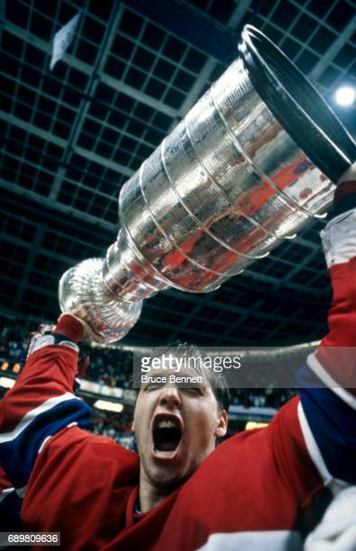 Goalie Patrick Roy of the Montreal Candiens celebrates with the Stanley Cup Trophy after defeating the Calgary Flames in Game 5 of the 1986 Stanley...